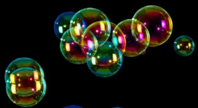 Isolated on black soap bubbles